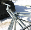 Towing frame with spring suspension